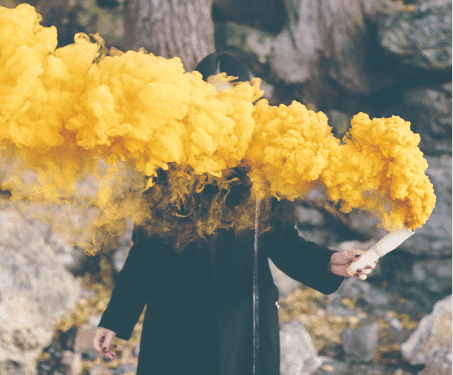 Girl holding yellow smoke