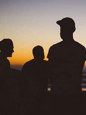 Silhouettes of men in caps